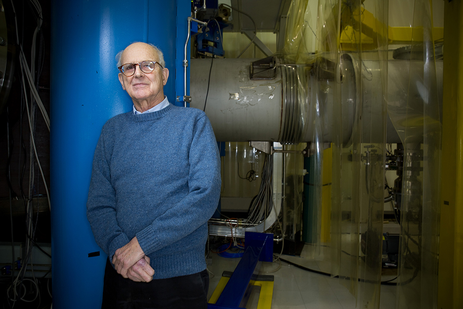 Rainer Weiss leaning up against blue pipe