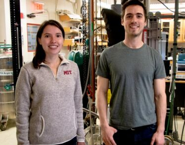 MIT physics graduate student Dahlia Klein (left) and postdoc David MacNeill pose in lab