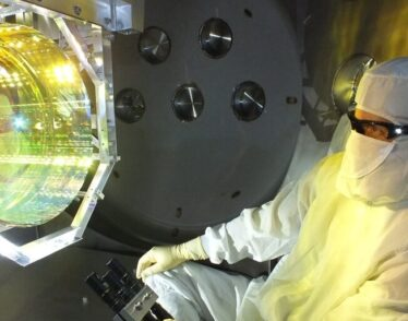 LIGO optics technician inspects one of LIGO's mirrors