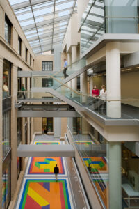 Photo displaying physics buildings 6 (left) and 6C (right) as well as Sol LeWitt's artwork Bars of Color within Squares (2007).