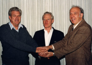 Taylor, Kendall, and Friedman celebrate receiving the 1990 Nobel Prize for Physics