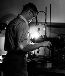 Henry W. Kendall, shown here as a graduate student at MIT experimenting with high-intensity microwave excited glow discharge.