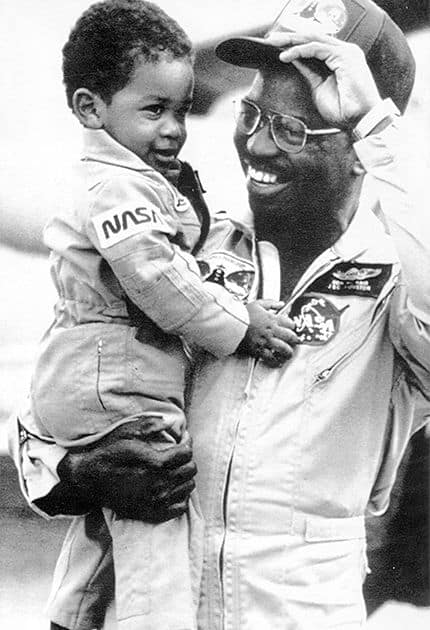McNair and his son, Reginald, in the early 1980s.