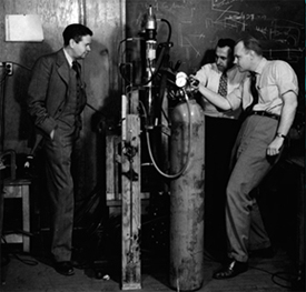 John C. Slater (left) watches Associate Professor Melvin A. Herlin (right) and a technician in the low-temperature laboratories of the Research Laboratory of Electronics (RLE), 1949.