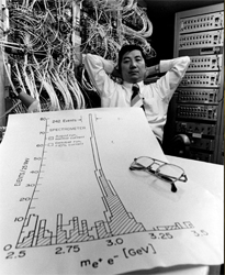 Samuel C.C. Ting along with a data proving the existence of the new 'J' particle.