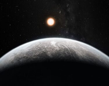 Artist's conception of a super Earth exoplanet with its star in the background.