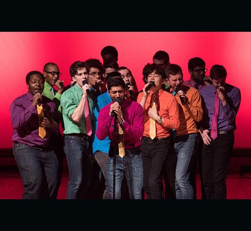 Photo showing MIT senior Shaun Datta, at center performing with his fellow MIT Logarhythms.