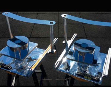 Two versions of the device designed by MIT researchers, using a strip of metal to block direct sunlight to confirm that they could provide cooling without power.