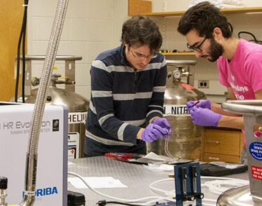Riccardo Comin (left), an assistant professor of physics, and physics graduate student Abraham Levitan in lab.