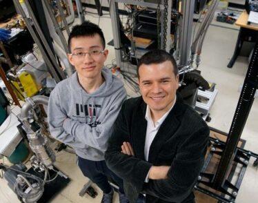Graduate student Yuan Cao (left) and Professor Pablo Jarillo-Herrero