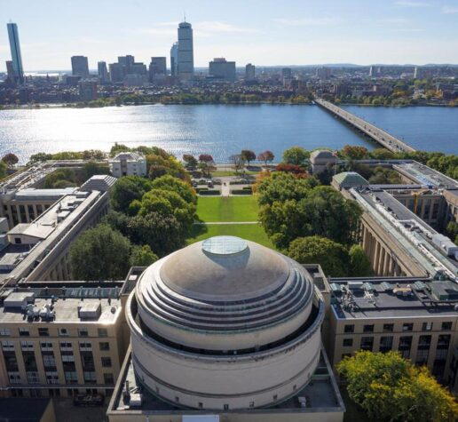 Aerial photo of the MIT dome and Killian Court facing the Charles River and Boston.
