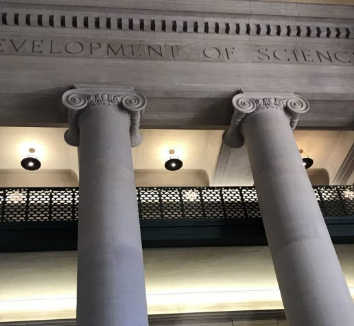 Photo of columns and balconies in MIT Lobby 7 with the etched words