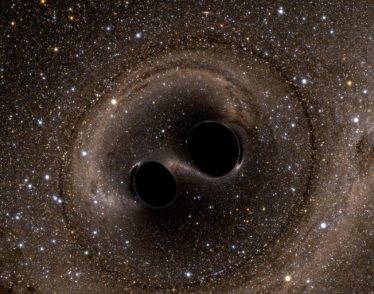 A computer simulation shows the collision of two black holes, detected for the first time by the Laser Interferometer Gravitational-Wave Observatory (LIGO) in 2015.
