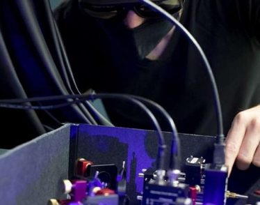Researcher looks at 420 mm laser.